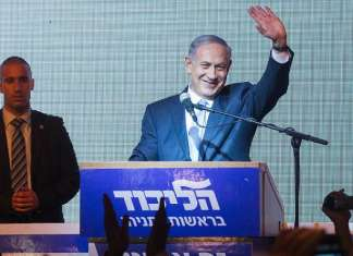 Israeli Prime Minister Benjamin Netanyahu waves to supporters at Likud headquarters in Tel Aviv on March 18, 2015, after general elections with Netanyahu claiming victory. Photo by Miriam Alster/Flash90