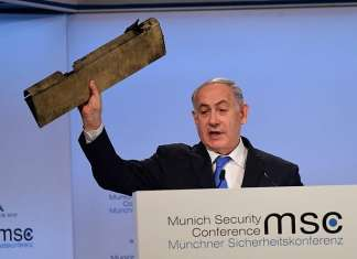 Israeli Prime Minister Benjamin Netanyahu displays a fragment of an Iranian drone destroyed over Israeli airspace in February during his speech at the Munich Security Conference. Credit: GPO.