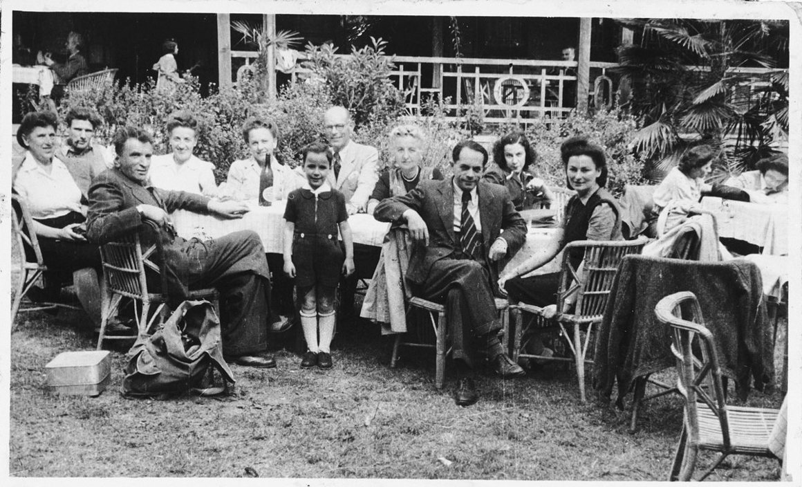 Jewish refugees socialize in a garden in Shanghai.