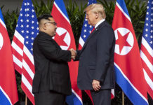 Kim and Trump shaking hands at the red carpet during the DPRK–USA Singapore Summit by Shealah Craighead. Public domain via Wikimedia Commons.