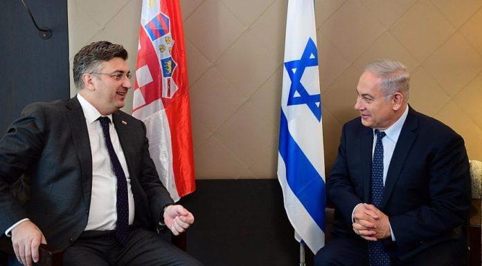 Israeli Prime Minister Benjamin Netanyahu and Croatian Prime Minister Andrej Plenković meet at the World Economic Forum in Davos, Switzerland, on Jan. 25 2018. Credit: Amos Ben-Gershom/GPO.
