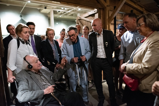 Holocaust Survivor Roman Kent sharing his experience with German State Secretary Dr. Rolf Bosinger, in a cattle car like those used to deport Jews, at the United States Holocaust Memorial Museum during negotiations for increased social services for Holocaust survivors.
