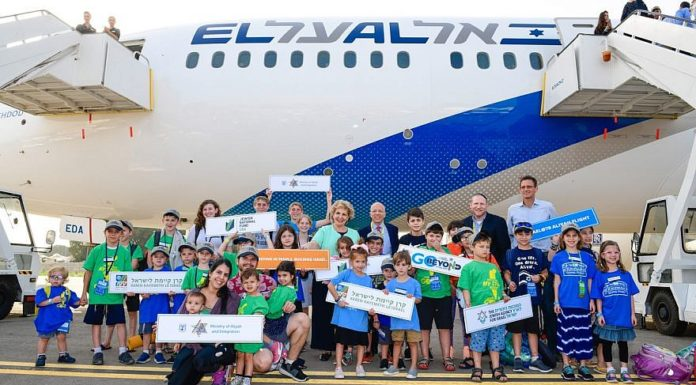 Children land at Ben-Gurion Airport and are greeted by Nefesh B'Nefesh co-founders Rabbi Yehoshua Fass and Tony Gelbart, as well as Israel's Minister of Aliyah and Integration, Sofa Landver. Credit: Photo by Shahar Azran.