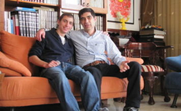 The late Hadar Goldin (left) with his father, Simcha. Credit: Courtesy of the Goldin family.