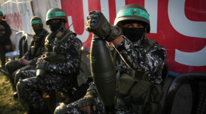 Hamas members take part in a rally marking the Palestinian terror group's 29th anniversary in Gaza on Dec.16, 2016. Credit: Abed Rahim Khatib/Flash90.