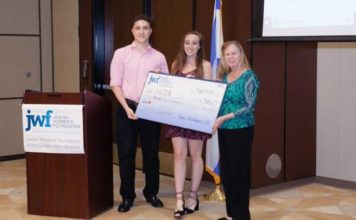 From left, students Brandon Gerardi and Mia Evans along with Pam O'Brien, chief executive officer of Aid to Victims of Domestic Abuse, one of the organizations to receive a grant from the No Small Change program. (Jewish Women's Foundation/Courtesy)