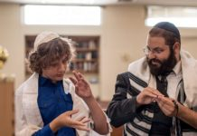 Rabbi Yehoshua Soudakoff, Executive Director, The Jewish Deaf Foundation, working with a student. Courtesy.