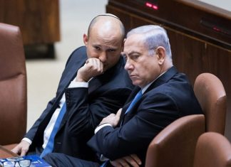 Israeli Prime Minister Benjamin Netanyahu speaks with Education Minister Naftali Bennett during a plenum session in the assembly hall of the Israeli parliament on Nov. 13, 2017. Photo by Yonatan Sindel/Flash90.