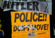 """Anti-Semitic vandalism on the locker (pictured here) of former New York Police Department officer David Attali included swastikas, the words """"dirty Jew,"""" pictures of ham or bacon (which are prohibited under Jewish dietary laws), and newspaper clippings that read: """"Hail Hitler."""" Credit: Courtesy."""