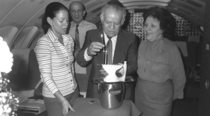 Former Israeli Prime Minister Yitzhak Shamir flanked by his wife, Shulamit, and a hostess lighting Hanukkah candles on their return flight from Washington, on Feb. 12,1983. Credit: GPO.